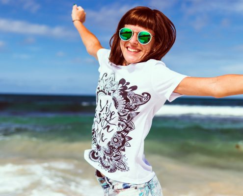 woman jumping sunglasses